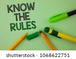 Small photo of Handwriting text writing Know The Rules. Concept meaning Understand terms and conditions get legal advice from lawyers written Plain Green background Pens next to it.