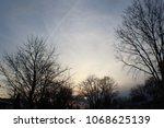 sunset middle class neighborhood | Shutterstock . vector #1068625139