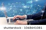 businessman typing on laptop... | Shutterstock . vector #1068641081