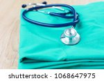 stethoscope on a table with... | Shutterstock . vector #1068647975
