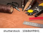 tools for leather crafting and... | Shutterstock . vector #1068649841