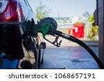 car refueling on petrol station.... | Shutterstock . vector #1068657191