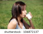 young woman during warm  sunny... | Shutterstock . vector #106872137