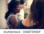 pregnant women in class | Shutterstock . vector #1068734069