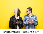 two mixed race friends with... | Shutterstock . vector #1068755474