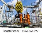 offshore construction workers... | Shutterstock . vector #1068761897