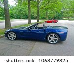 Small photo of TEANECK, NEW JERSEY/USA - JUNE 11, 2012: A blue late model Corvette convertible parked in the parking lot of a local golf course during an outing to raise funds for charity.