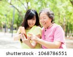 happy senior mother and... | Shutterstock . vector #1068786551