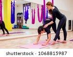 women exercising in a gym | Shutterstock . vector #1068815987