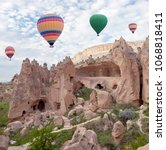 Small photo of Colorful hot air balloons flying over Zelve valley in Cappadocia, Anatolia, Turkey
