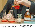 students experimenting and... | Shutterstock . vector #1068828035