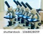 school microscopes for students ... | Shutterstock . vector #1068828059