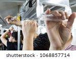 passangers holding the hand... | Shutterstock . vector #1068857714