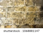 old stone brickes wall... | Shutterstock . vector #1068881147