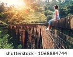woman sits on the demodara nine ... | Shutterstock . vector #1068884744