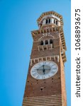 Small photo of Beautiful architecture in Verona with old town, ruins, street clock, Dante monuments and main tower.