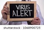 virus alert warning written on... | Shutterstock . vector #1068900725