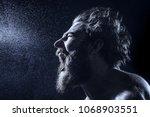 naked bearded man angrily... | Shutterstock . vector #1068903551