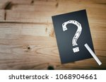 Small photo of Question mark on wooden desk background. Concept for confusion, question or solution.