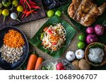 thai papaya salad or what we... | Shutterstock . vector #1068906707