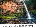 massive red cliff face... | Shutterstock . vector #1068909179