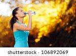 athlete refreshing with bottle... | Shutterstock . vector #106892069