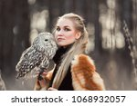 blonde woman with an owl in her ... | Shutterstock . vector #1068932057