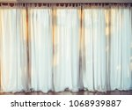 white curtain in the morning... | Shutterstock . vector #1068939887