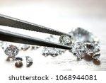 brilliant cut diamond held by...   Shutterstock . vector #1068944081