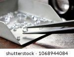 brilliant cut diamond held by... | Shutterstock . vector #1068944084