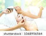 attractive young women lying on ... | Shutterstock . vector #1068956564