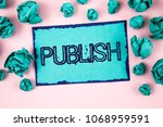 writing note showing  publish.... | Shutterstock . vector #1068959591