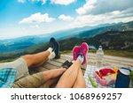 legs of traveler family | Shutterstock . vector #1068969257