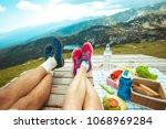 legs of traveler couple | Shutterstock . vector #1068969284
