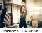 fit young woman in sportswear... | Shutterstock . vector #1068984785