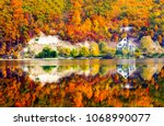 autumn mountain forest lake... | Shutterstock . vector #1068990077