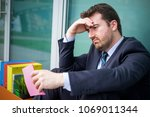 sad manager after reading... | Shutterstock . vector #1069011344