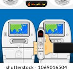 airplane seat entertainment... | Shutterstock .eps vector #1069016504