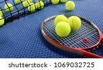 tennis racket with tennis balls ... | Shutterstock . vector #1069032725