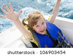 two kids sitting in the bow of... | Shutterstock . vector #106903454