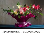 bouquet of flowers on the old... | Shutterstock . vector #1069046927