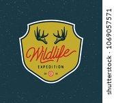 vintage wilderness logo. hand... | Shutterstock .eps vector #1069057571