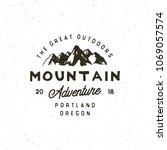 vintage wilderness logo. hand... | Shutterstock .eps vector #1069057574