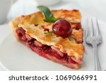 delicious piece of cherry pie... | Shutterstock . vector #1069066991