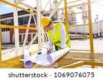 female architect or engineer... | Shutterstock . vector #1069076075