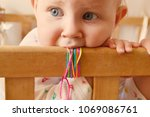 the child is playing in a baby... | Shutterstock . vector #1069086761