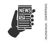 hand holding smartphone glyph... | Shutterstock .eps vector #1069095641