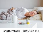 woman suffering from abdominal... | Shutterstock . vector #1069136111