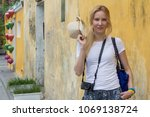 cheerful young woman tourist... | Shutterstock . vector #1069138724