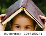 child girl with book over her... | Shutterstock . vector #1069150241